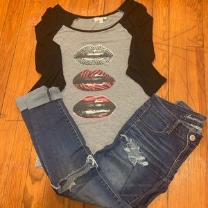 Woman's ripped jeans and quarter length shirt